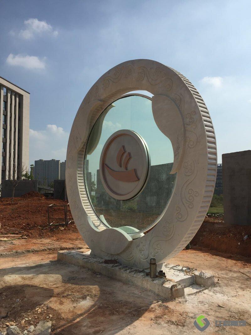 江西雕塑厂家:航达建设总部大楼-汉白玉石雕案例